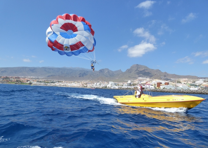 Experience freedom and fly over the ocean with a parascending session