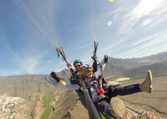 Fly over the stunning south coast of Tenerife in a tandem paraglider