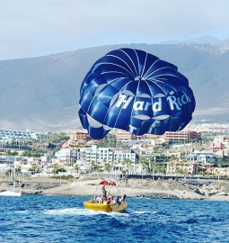 Fly over the water in this breathtaking parascending experience